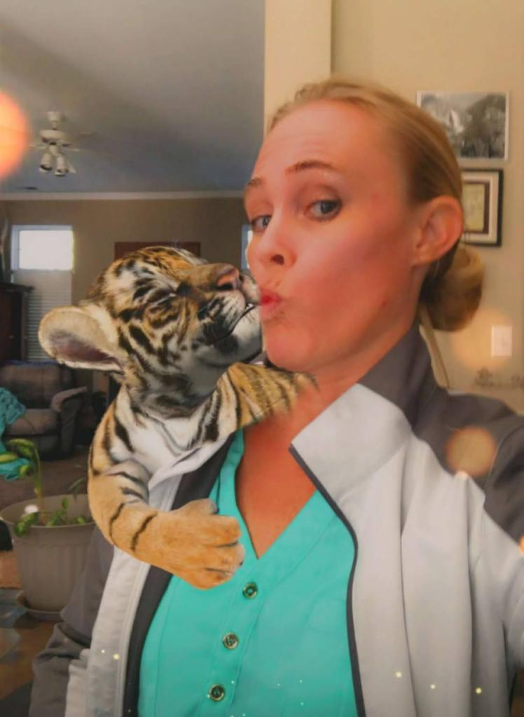 This image has an empty alt attribute; its file name is kaz-with-a-tiger.jpg